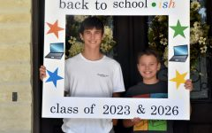 """Caleb Stemmans, 10, and his brother Ethan, 7, created a frame the night before their first day back at school that said """"Back to school-ish."""" They chose virtual learning this school year. """"I'm most looking excited about the flexible login, having the flexibility for the most part,"""" Caleb said."""