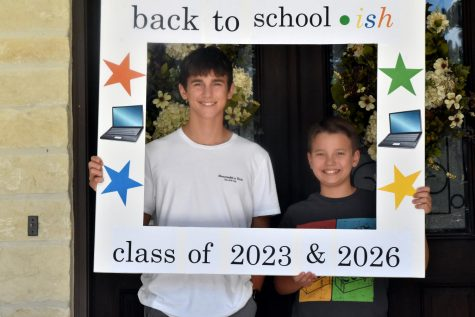 "Caleb Stemmans, 10, and his brother Ethan, 7, created a frame the night before their first day back at school that said ""Back to school-ish."" They chose virtual learning this school year. ""I'm most looking excited about the flexible login, having the flexibility for the most part,"" Caleb said."