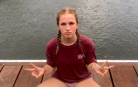 Grace Byrd hangs out near the water during church camp in the summer. She tested positive for COVID-19 soon after returning home.