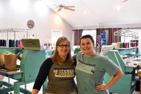 LindaSue and Shelby Laird stand in front of Shelby's living room. They moved Material Wonders into Shelby's home this fall.