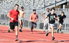 During seventh period track practice on Jan. 14, the boys track team warms up. Many are looking forward to finally hitting the track again since last season was cut short because of COVID-19.