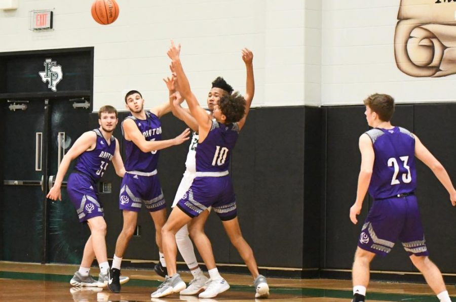 Senior Brent Jamison passes the ball out to an open teammate against Dayton in a 56-40 victory at home.