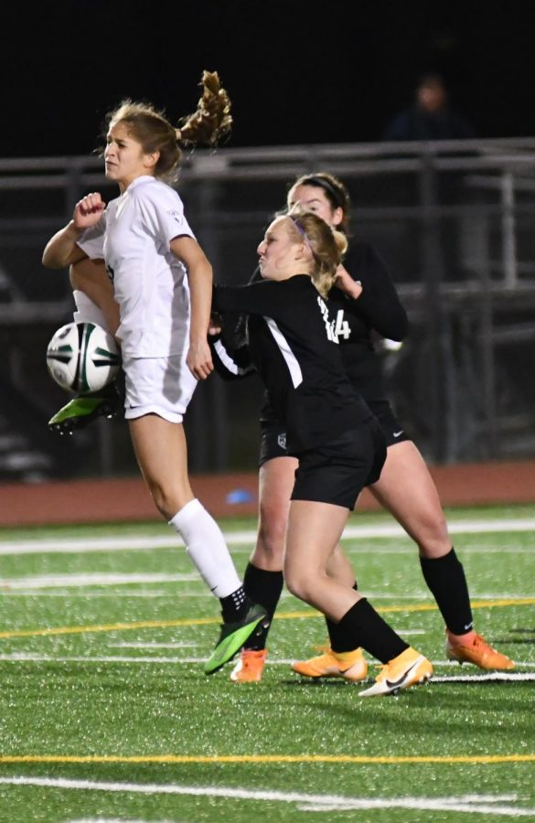 Freshman Brynn Baldon and senior Casey Smoot defend a Klein Collins player on a throw in during the 1-1 tie.