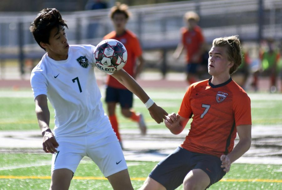 Senior forward Jesus Cervantes works to settle the ball against a Bridgeland defender on Jan. 14 at home.
