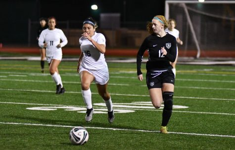 Sophomore Emma Yeager dribbles up the field and looks for a teammate to cross to against Klein Collins on Jan. 12. The Panthers tied Klein Collins 1-1.