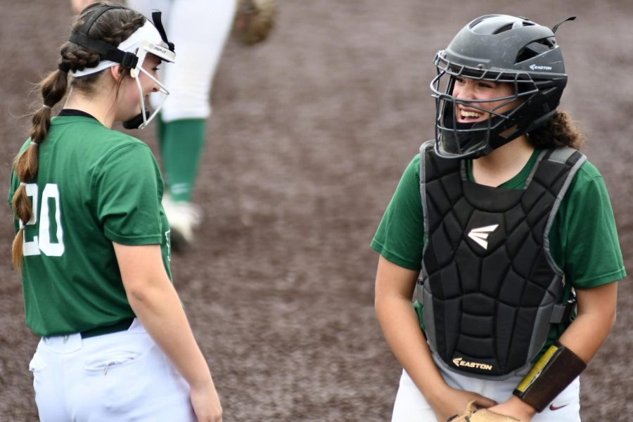 Sophomore pitcher Hannah Leierer and senior catcher Keyla Martinez meet on the mound in between pitches during the first game at Turner Stadium on Jan. 30.