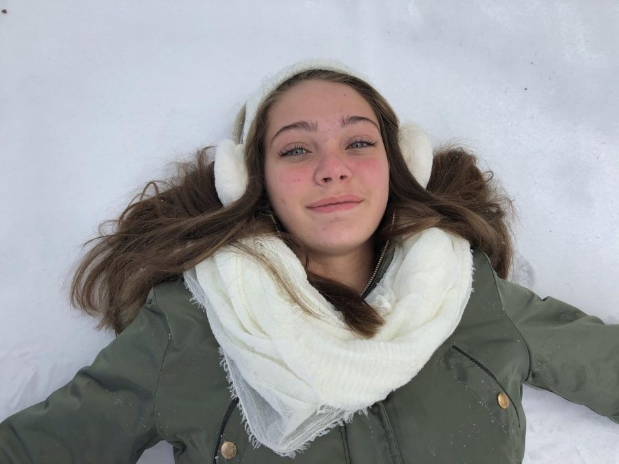 Freshman Brooke O'Brien enjoys the snow on Feb. 15. School was canceled for the day and remained out for the entire week.