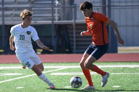 Senior forward Jace Banning faces off against a Bridgeland player on Jan. 14. The Panthers lost 2-0.