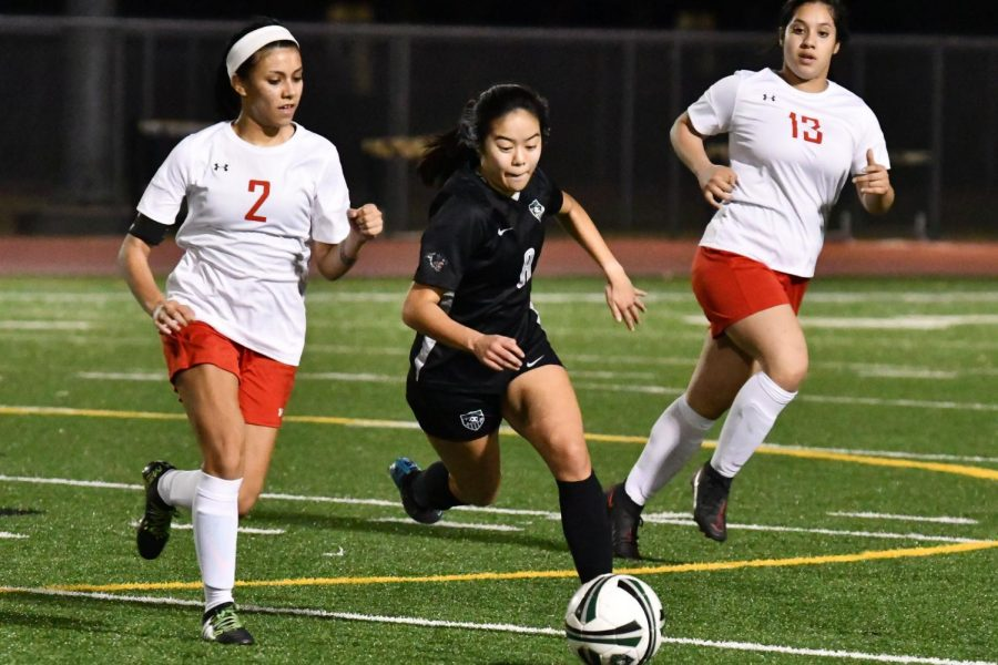 Senior captain Lori Do sprints past Cleveland senior Yulizma Mota in the 8-0 victory on Jan. 26.