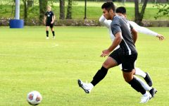 Senior Gage Guerra runs past a defender. He led the team with three goals and two assists in the 8-2 victory.