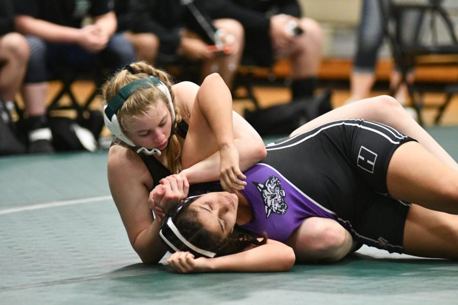 Senior Maddie Sandquist turns her Humble opponent as she gets ready to pin her on March 10. Sandquist is ranked No. 1 in the state.