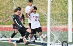 Senior Jace Banning just misses the goal in the first half of the team's second round game against Weiss on April 2.