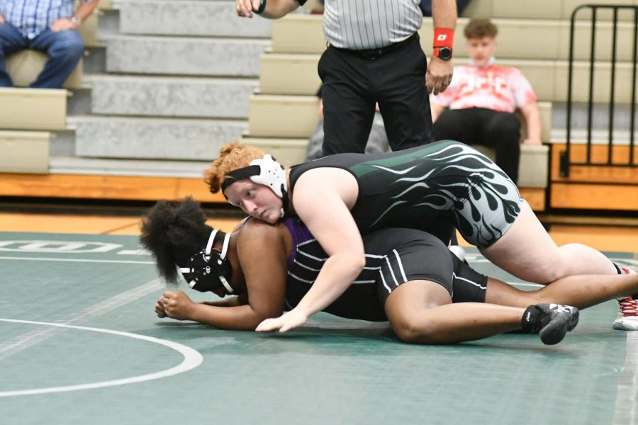 Junior Lexi Shannon works to turn an Humble opponent before pinning her. Shannon will wrestle in her third state championship meet on April 23.