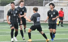 Gage Guerra, 12, celebrates with Nathan Jimerson, 12, Trey Ricker, 11, and Julian Guerra, 11, after scoring the first goal of the game against Foster in the regional semifinal.