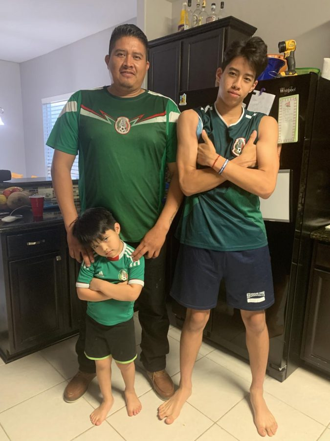 Jesse Cervantes, his father Gilbert and younger brother Adan get ready to watch a Mexico soccer game on July 2.