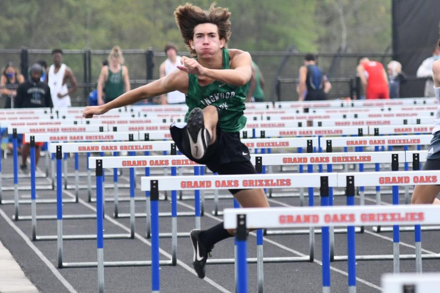 Jakob Keneipp, 12, competes in the 110 meter hurdles on March 27. He finished in a time of 16.52.