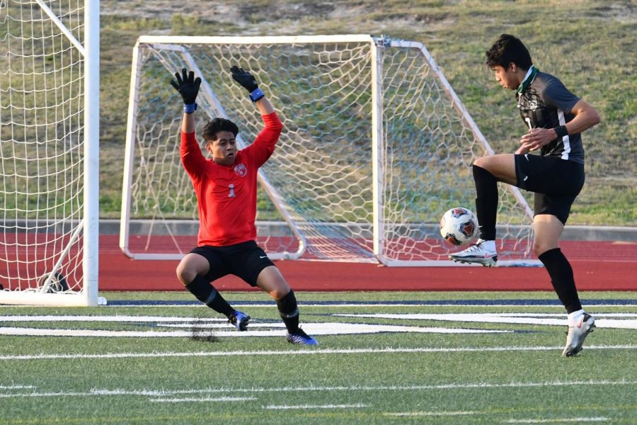 Senior Jesus Cervantes takes a shot against the Hendrickson goalkeeper to score the first goal of the game on April 9. The Panthers went on to win the Region Final, 6-2.