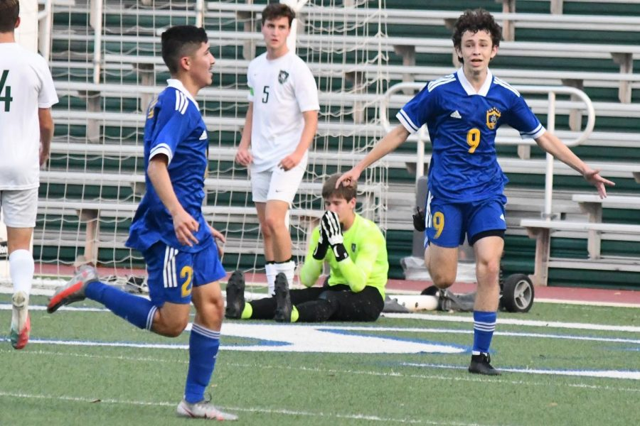 With Kingwood Parks Brandon Rogers and goalkeeper Thor Yeager watching, Pharr Valley View celebrates as it takes a two-goal lead in the state semifinals.