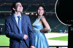 Andres Aristimuno and Sofia Garcia pose for the photo booth ring light at prom on May 1.