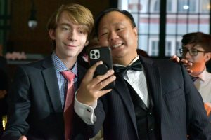 Senior Ian Prigmore takes a selfie with calculus teacher Jim Dang during prom. Dang chaperoned the dance from 8-11 p.m.