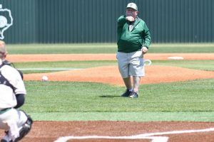 Science teacher Joe Ehrhardt throws out the ceremonial first pitch prior to the Dayton game on April 24. Ehrhardt is retiring after 42 years in education.