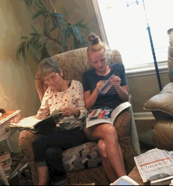 Emma and her grandma Nicki sit together on a chair. They spent many days together during Emma's entire childhood.