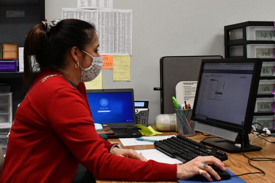 Algebra teacher Claire Kerr works on Schoology during downtime in May.
