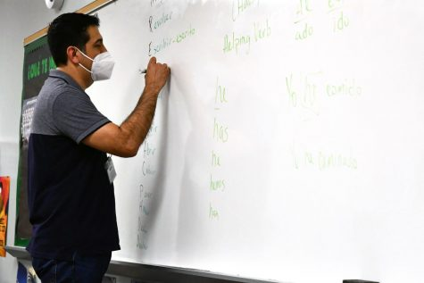 Jose Sanchez works on conjugations with his seventh period class in May.