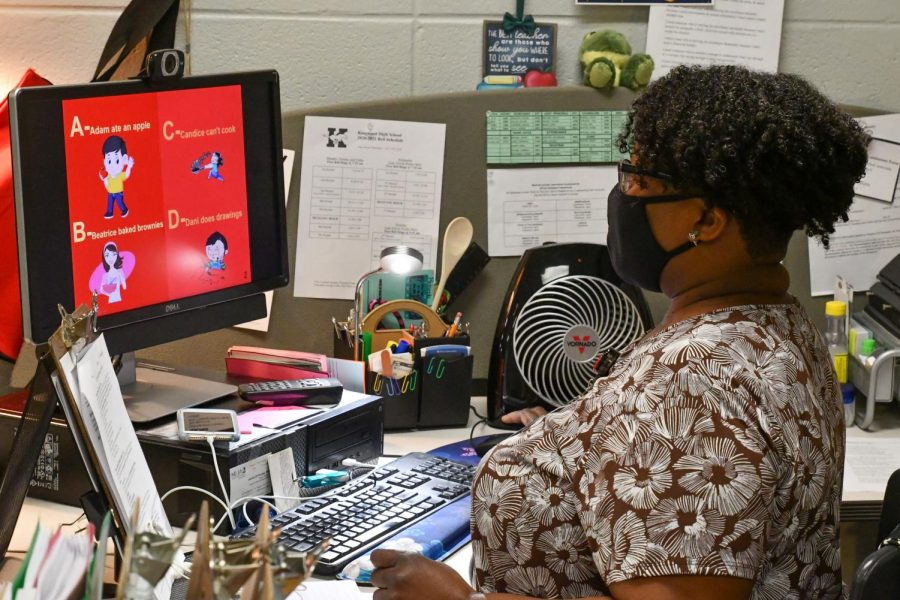 Family & Consumer Science teacher Rolanda Wilkins works on grading her students' projects.