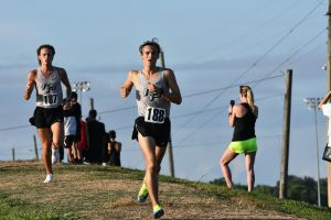Seniors Kade Terrell and Barrett Kenny compete in the first leg of the Huffman Relays race on Aug. 14.