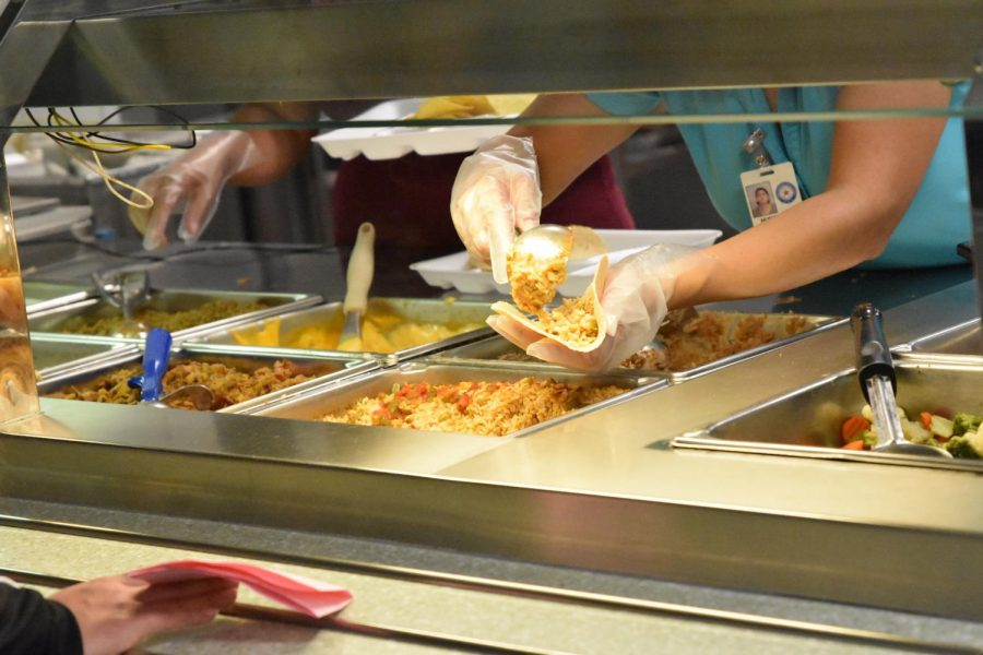 Cafeteria workers stand by to create meals just as kids order them in the Rally Cafe.