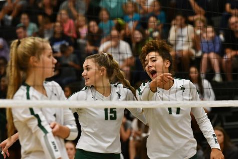Senior Charlee Jordan helps give direction on the court with junior Ashley Cox and senior Ashley Forrest lining up in the front row with her. The Panthers lost in four sets to Kingwood HS on Aug. 20.