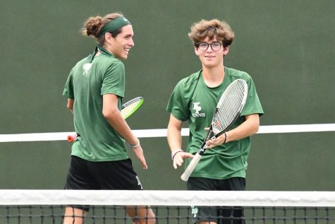 Juniors Sean Helton and Talmage Hammond celebrate after scoring a point in their doubles match on Aug. 13.