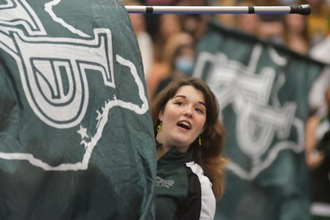 Suzanne Durand, 12, performs a routine with the color guard during the First Day pep rally.