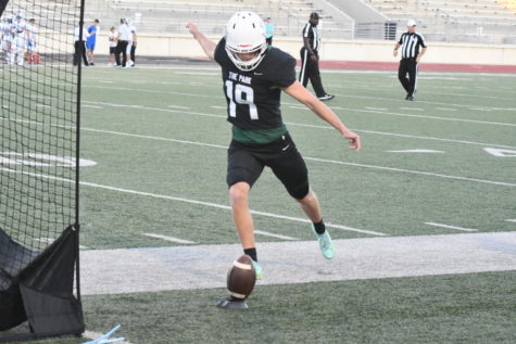 Tony Sterner practices kicking at Turner before a  varsity game against Barbers Hill.