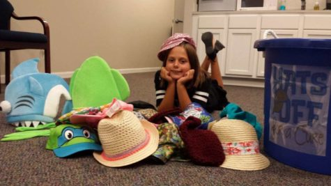 As a fourth grader, Kaitlyn Sitton is surrounded by just a few of the hats she collected for Texas Childrens Hospital during Pediatric Cancer Awareness Month. She has continued to do the service project every year since.