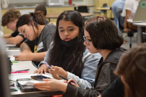 During Introduction to Culinary Arts, Hazel Mendez, 9, Itati Lainez, 10 and Saranna Vasquez, 9, work on their assignments.