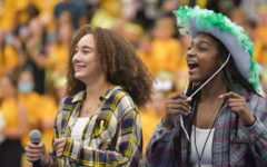 Seniors Charlee Jordan and Amri Williams talk to the students at the pep rally on Sept. 17, encouraging them to attend the volleyball game.