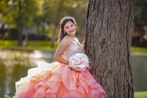 Kaitlyn Gonzalez, 12, takes celebration photos in her quinceañera dress.