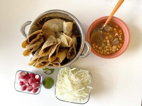 A meal of tacos dorados and pozole.