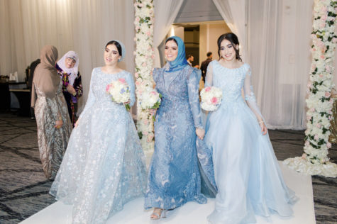 Junior Meraa Husainat walks down the aisle with family members during her brother's wedding last summer.
