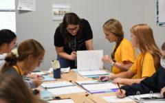 Math teacher Caroline Wick does a notebook check with junior Carlie Solomon during Algebra II in September.
